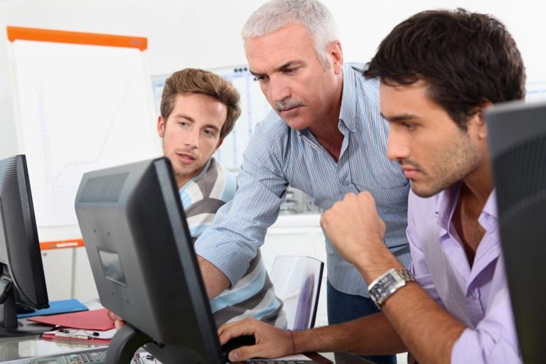 it consultant looking at computer